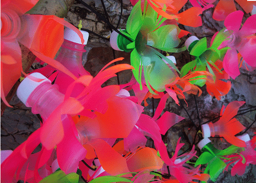 Eco crafts pretty plastic bottle flowers the healthy for Pretty plastic bottles